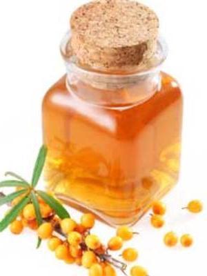 Candele con olio di olivello spinoso