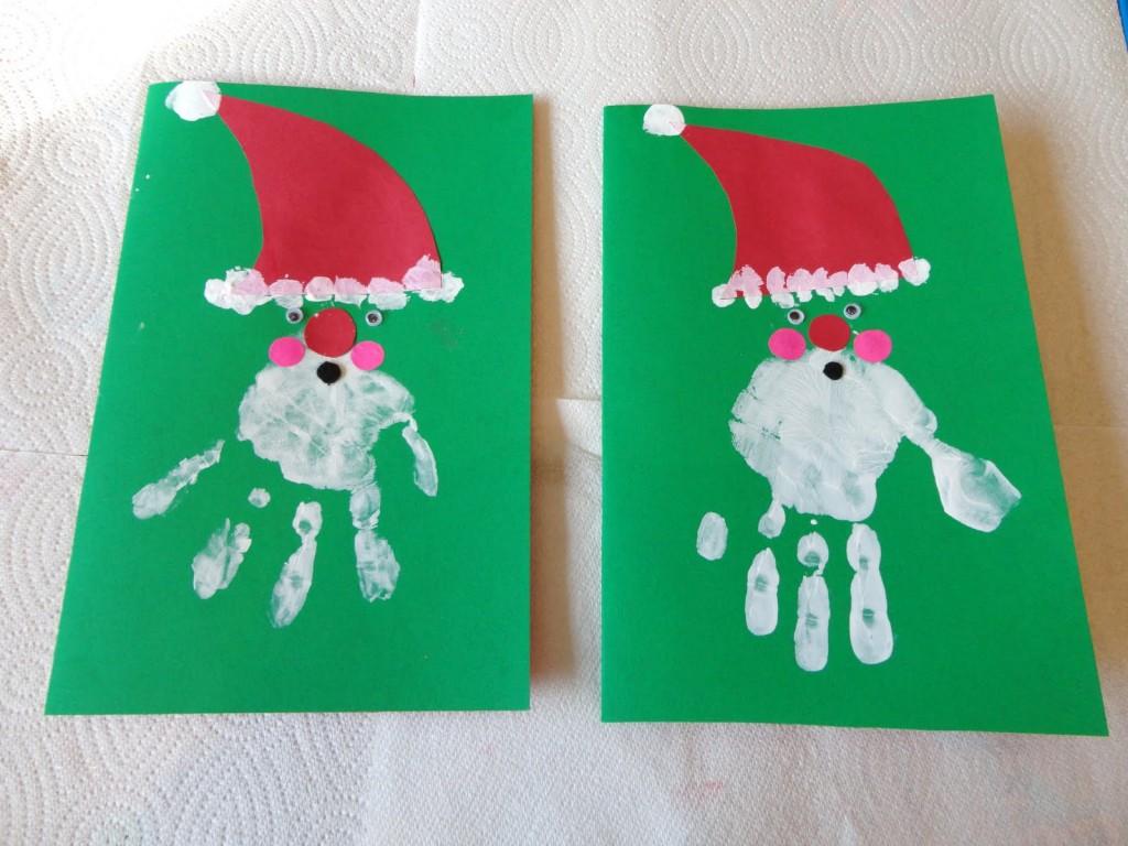 Babbo Natale con le sue mani ai bambini